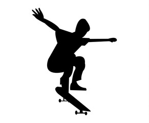Young boy on a skateboard jumping