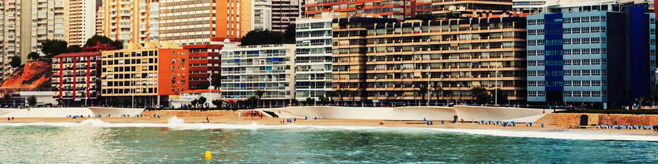 Summer resort Benidorm, Spain with beach and famous skyscrapers in the evening