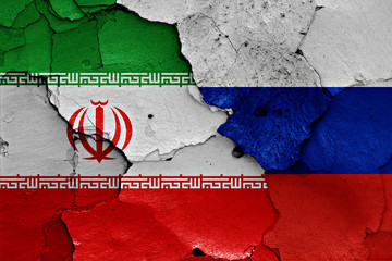 flags of Iran and Russia painted on cracked wall