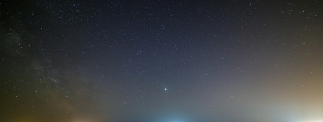 Night sky with a bright star of the Milky Way. Panoramic view of the starry space.
