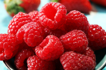 raspberries. Raspberry on blue background. Summer and healthy food concept