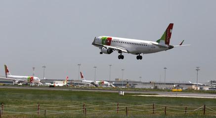 A Portuguese TAP Express Embraer ERJ-190LR plane lands at Lisbon's airport