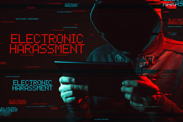 Electronic harassment concept with faceless hooded male person