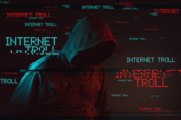 Internet troll concept with faceless hooded male person