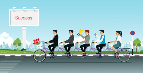 Group of business people together riding a Tandem bike with a trophy in hand.