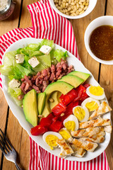 American garden salad Cobb salad with fresh vegetables and chicken