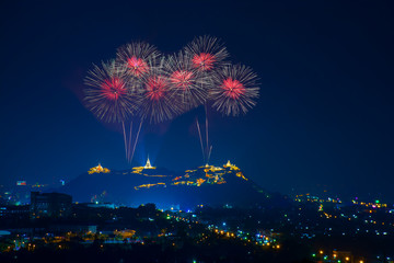 Beautiful red fireworks at night with temple on mountain view