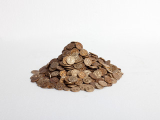 Pile of replica gold coins on white background