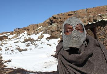 Man poses in a balaclava near the Letseng diamond mine in Lesotho