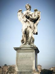 Angel statue atop pedestal