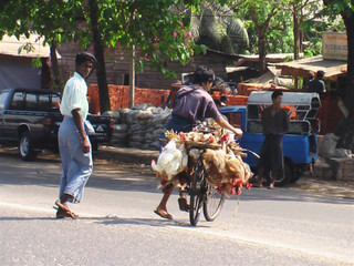 A retailer leaves the central chicken wholesale market in Yangon