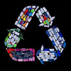 Recycling symbol made from plastic bottles trash - ecology concept, isolated on black