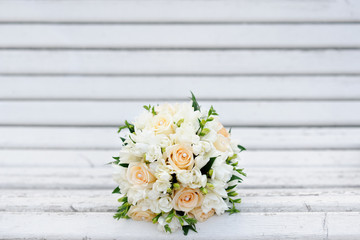 Bouquet of a bride on a white bench. Beautiful wedding bouquet.