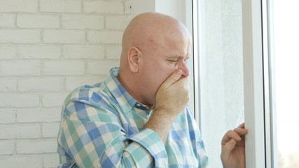 Disappointed Businessperson in Office Room on the Window Staying Worried
