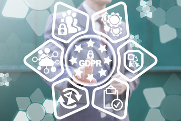GDPR - General Data Protection Regulation Security Concept. Businessman clicks on a gdpr with padlock and stars button surrounded by specific icons.