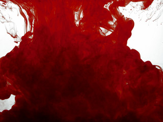 Red color pigment in water on white background