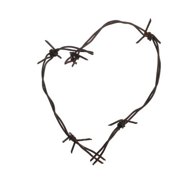 Old rusty frame barbed wire fence with shape heart isolated on white background