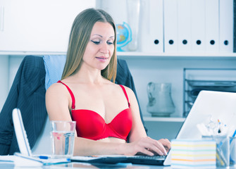 Businesswoman in red bra