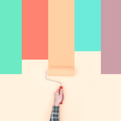 Decorator painting colorful stripes on a wall