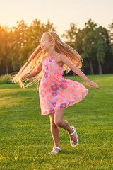 Little girl dancing, summer. Child on nature background. The energy of life.