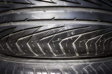 Close up picture of a used black car tire.