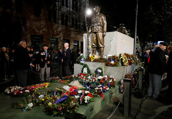 People gather around the Cenotaph after a dawn service on Anzac day in Sydney