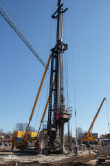 pile bore machine. A pile driver is a mechanical device used to drive piles, poles into soil to provide foundation support for buildings