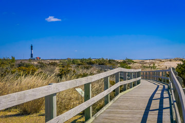 Outdoor view of long wooden bridge in a beautiful sunny day with blue sky, at Long island