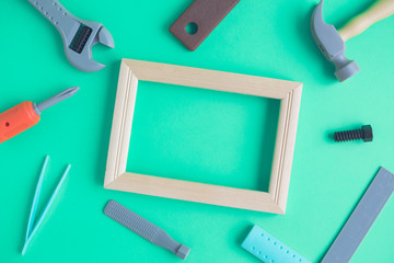 Flat lay of carpentry tools and picture frame abstract
