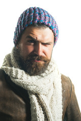 Male fashion. Casual bearded male in jacket, scarf and hat. Bearded hipster wearing demi-season clothing. Handsome man with beard and mustache in autumn-winter clothes. Autumn fashion, european style.