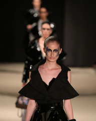 Models present creations by Peruvian designer Pat Sedano during Lima Fashion Week in Lima