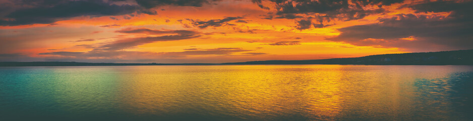 Photo Stands Deep brown Sunset over the lake. Amazing panorama landscape
