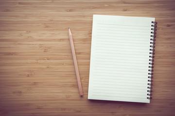 Blank notebook on desk background.