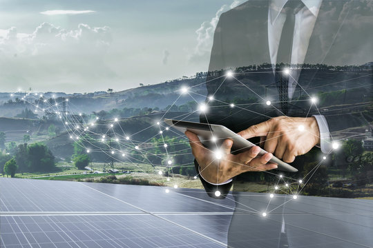 Solar Cells.Businessmen calculate investment.