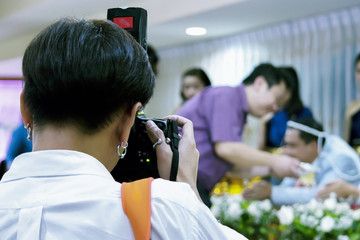 a wedding photographer takes pictures of the bride and groom.