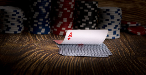 ace-card and poker chips, on a wooden background
