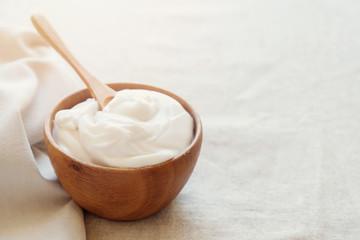 homemade organic coconut greek yogurt in wooden bowl