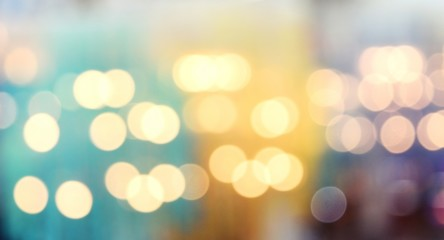 Abstract background,Bokeh from indoor lighting, The white and yellow circles spread on bright colored surface,Texture for add text or graphic design