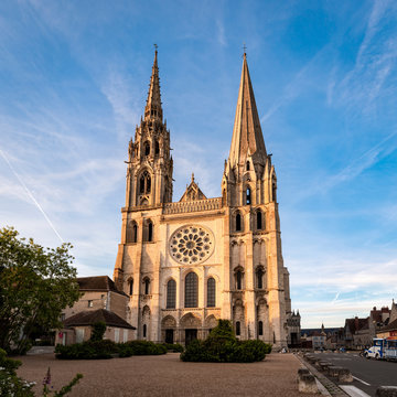 View of Chartres Cathedral West facade in sunset rays