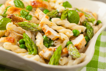 Italian pasta fusilli. Salad with chicken and asparagus in Béchamel sauce.