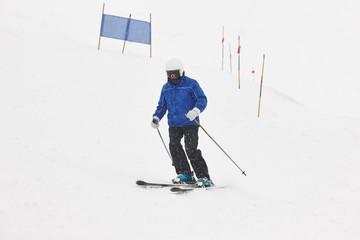 Skier under the snow. Winter sport. Ski slope