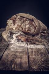 fresh bread and dark background.