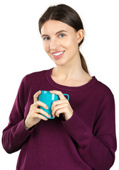 Young woman holding a mug with a hot drink isolated on white background