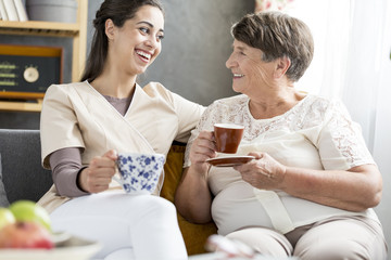 Volunteer drinking coffe with patient