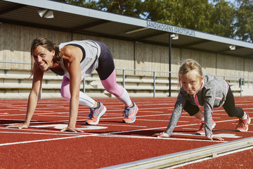 Mother and daughter on running track