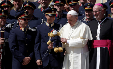 Pope Francis receives a gift from Austrian Police music band at the end of his Wednesday general audience in Saint Peter's square at the Vatican