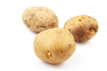 Three potatoes isolated on white
