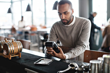 Man paying by card in restaurant