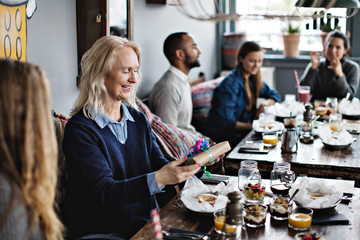 Woman holding gift in restaurant