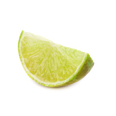 Juicy slice of lime isolated on a white background